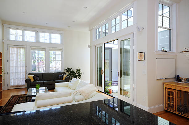 sunny home interior of open plan apartment - sliding stock photos and pictures