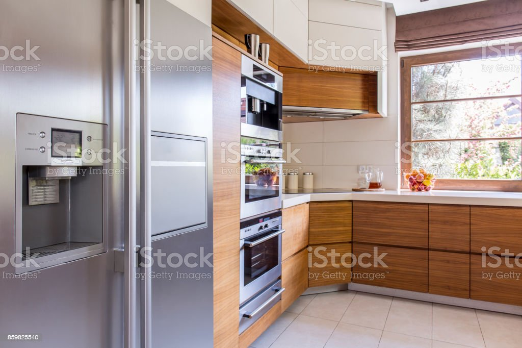 Sunny kitchen with all the necessary appliances stock photo