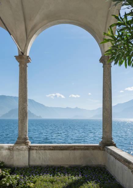 sunny lake como through an arch - lake como stock photos and pictures