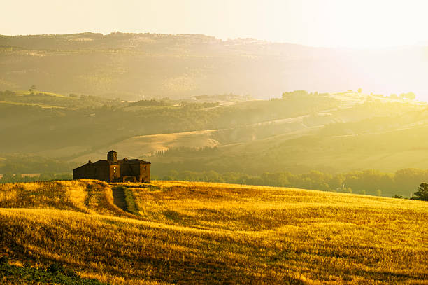 Sunny Landscape in Umbria Umbria, Italy - An old ruined country house on the top of the hill in a sunny morning. umbria stock pictures, royalty-free photos & images