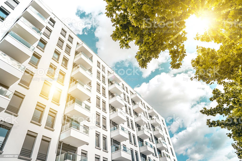 sunny  modern cubic white residential houses in berlin stock photo