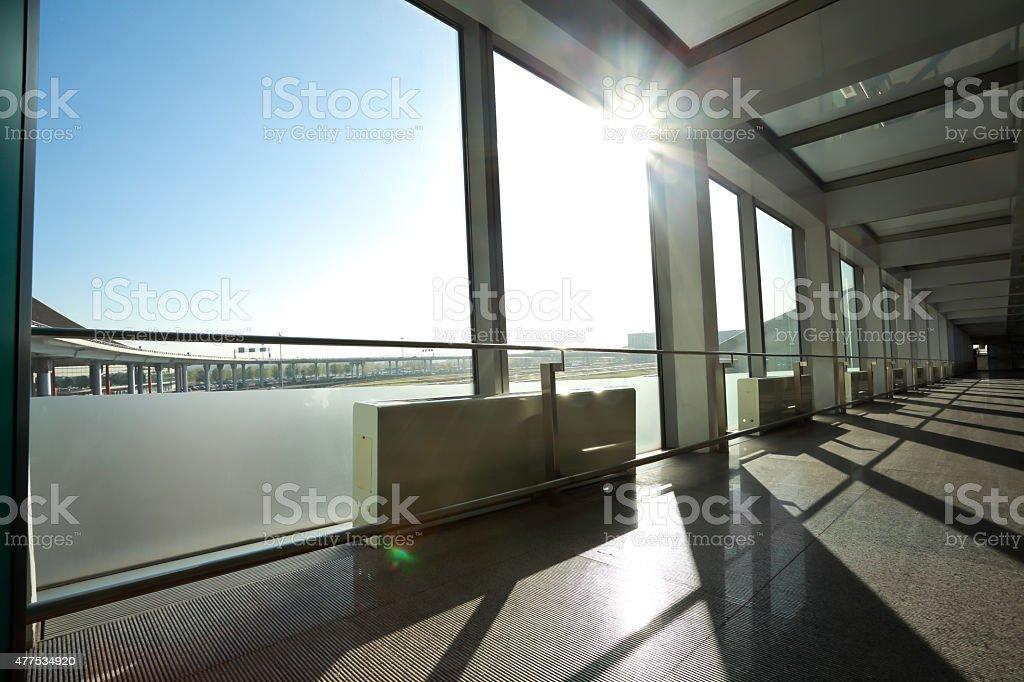 Sunny On Modern Glass Office Windows Building Interior Corridor  Royalty Free Stock Photo