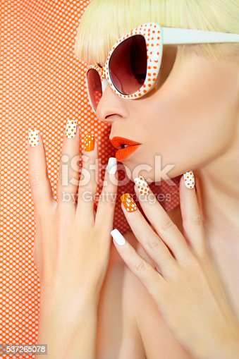 istock Sunny orange manicure and makeup. 537265078
