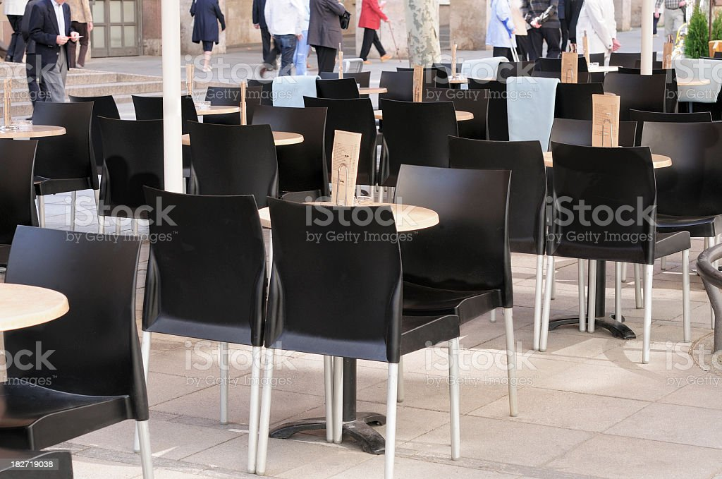 Sunny outdoor restaurant empty pedestrian zone people royalty-free stock photo