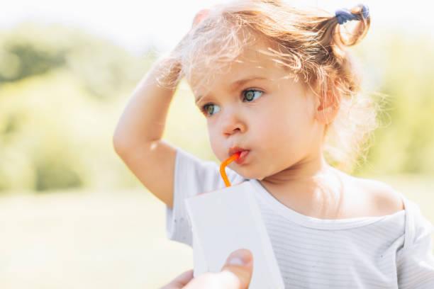 Sunny portrait of a little child drinking from a straw juiceon picture id958543514?b=1&k=6&m=958543514&s=612x612&w=0&h=zjdlmkp9ukaicoxz8ih5wnzh9u 9smufwesfemrnku8=