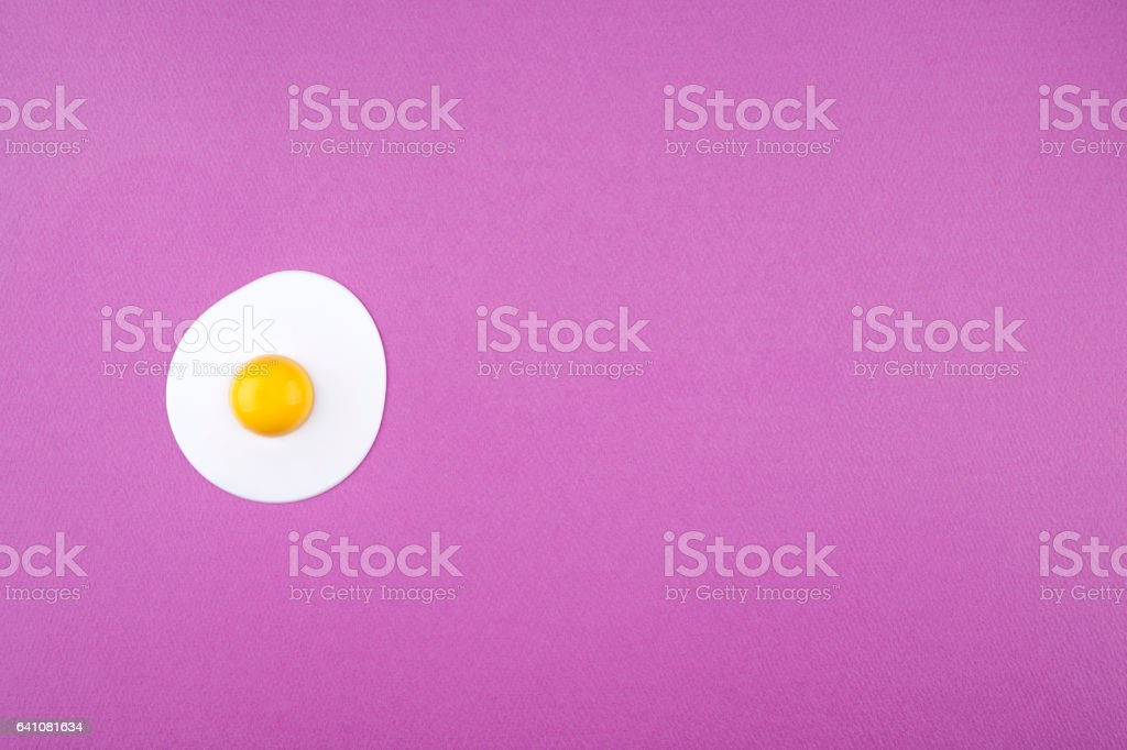 sunny side up egg on pink background stock photo