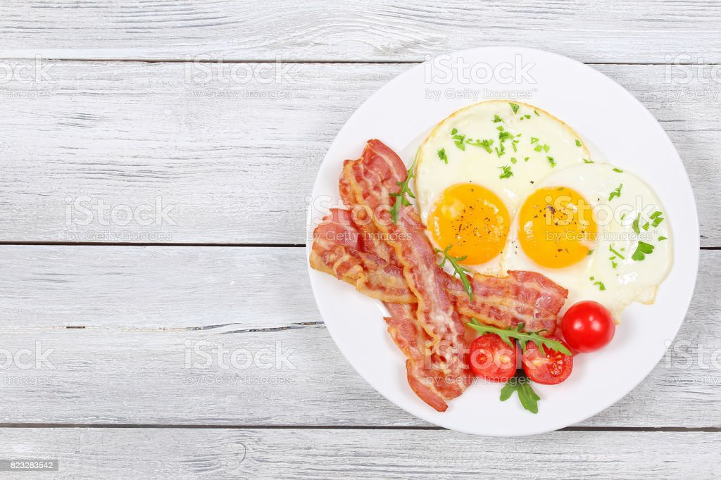 Sunny Side Up Eggs with bacon stock photo