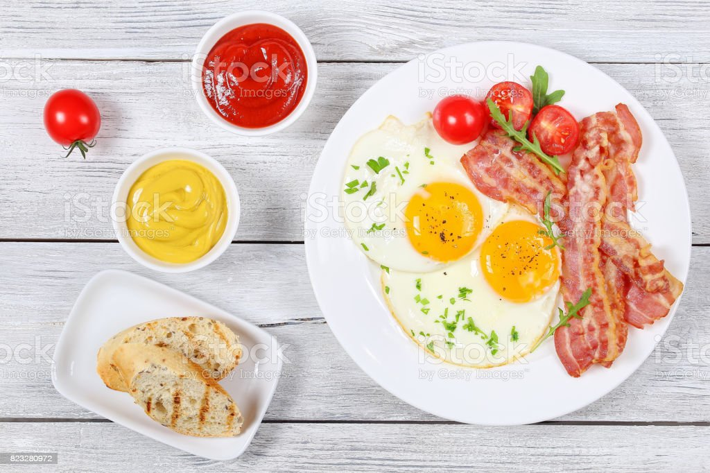Sunny Side Up Eggs with crispy bacon stock photo