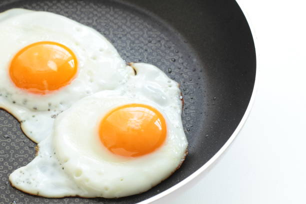 sunny side up fired egg - fried egg stock photos and pictures