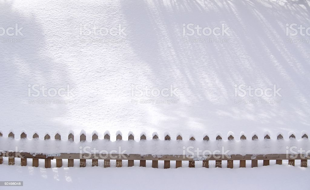 Sunny Snow Shadows and a Fence royalty-free stock photo
