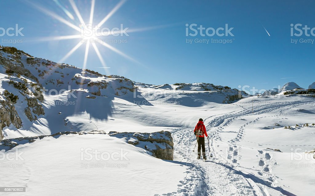 Sunny snowshoeing at Dachstein Winter Wonderland, Austria stock photo