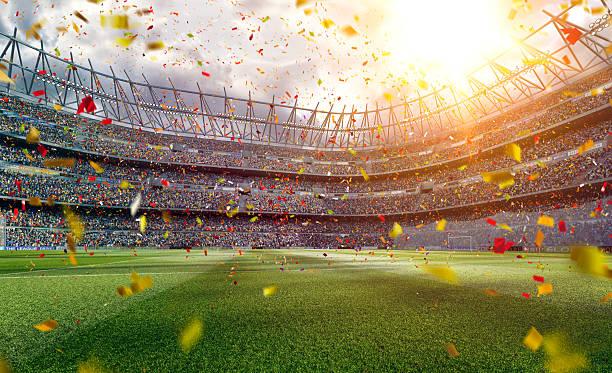 Sunny soccer stadium stock photo