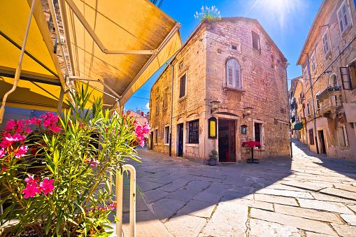 Sunny stone street of ancient Pula view, Istria region of Croatia