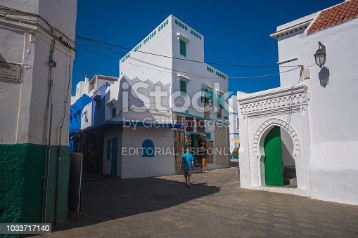 Asilah, Morocco - 8 September 2018 - Sunny street with traditional white building in the town of Asilah