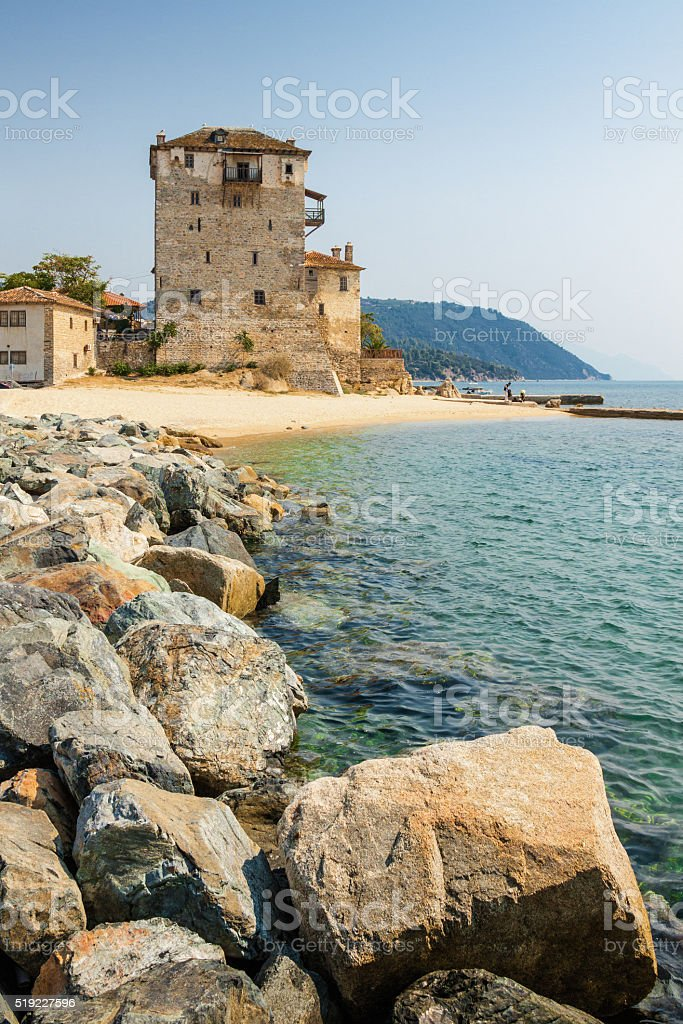 Sunny view of tower in Uranopolis bay, Greece. stock photo