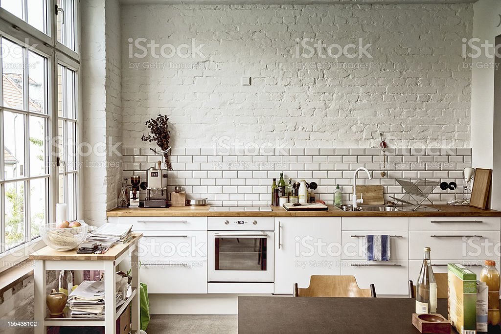 Sunny white European kitchen stock photo