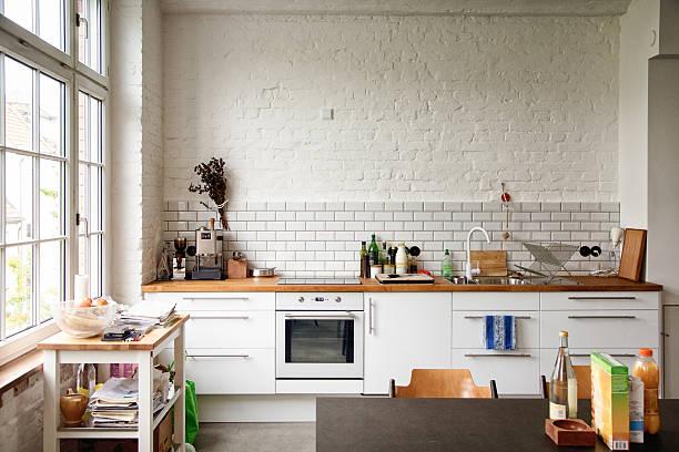 Sunny white European kitchen stock photo