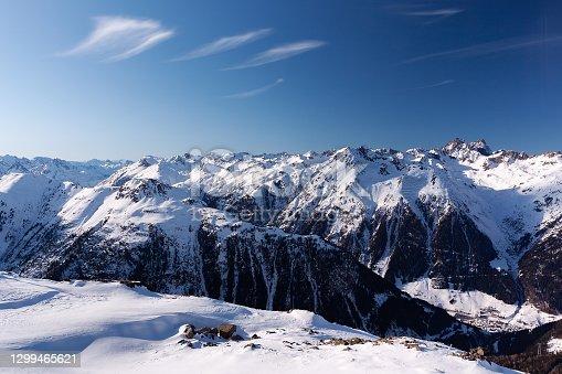 istock Sunny winter day in alpine ski resort with blue sky and bright white snow, Ischgl and Samnaun, Silvretta Arena, Austria - Switzerland 1299465621