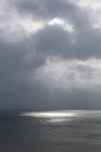 Sunrays coming through the clouds over The English Channel and reflects the light in the water