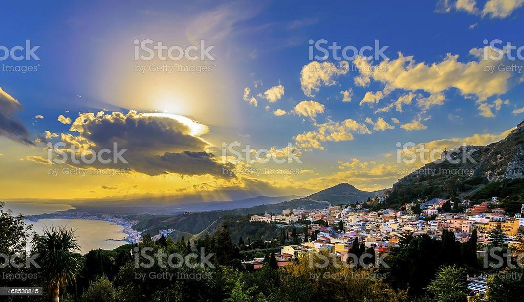 Sunrays over Taormina, Sicily stock photo