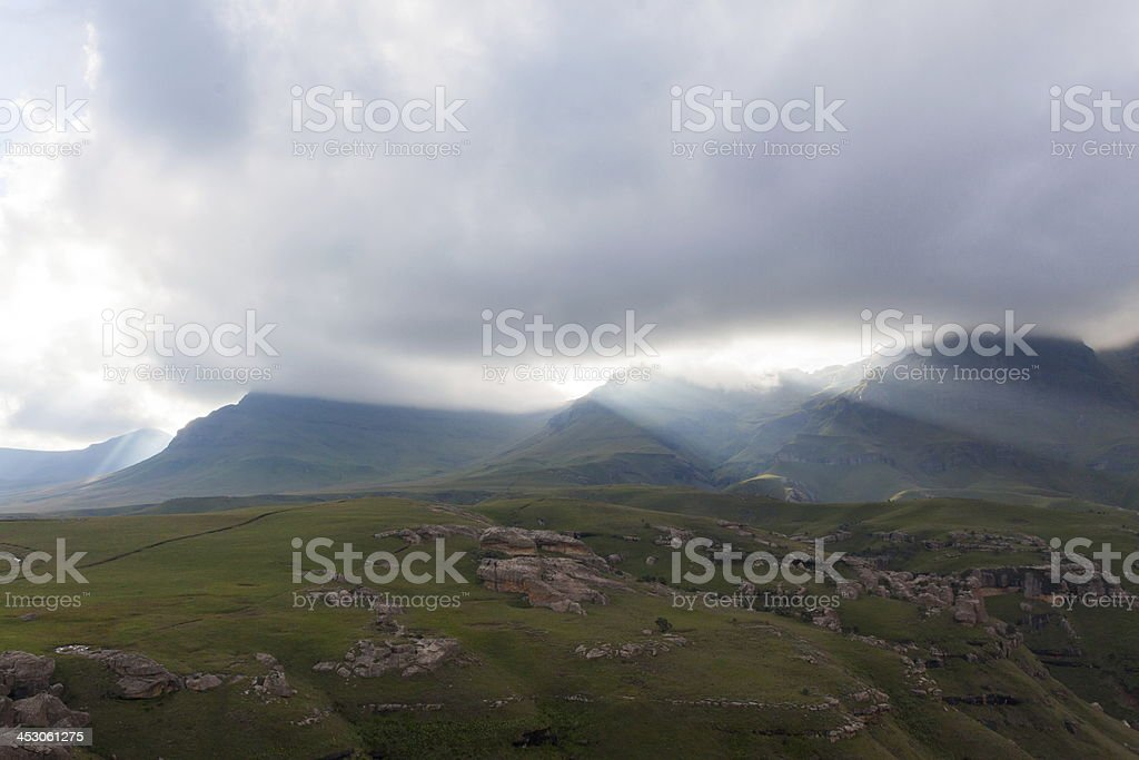 Sunrays through the clouds stock photo