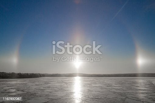 Rare effect of the sun rays over Kemijoki River in Northern Finland