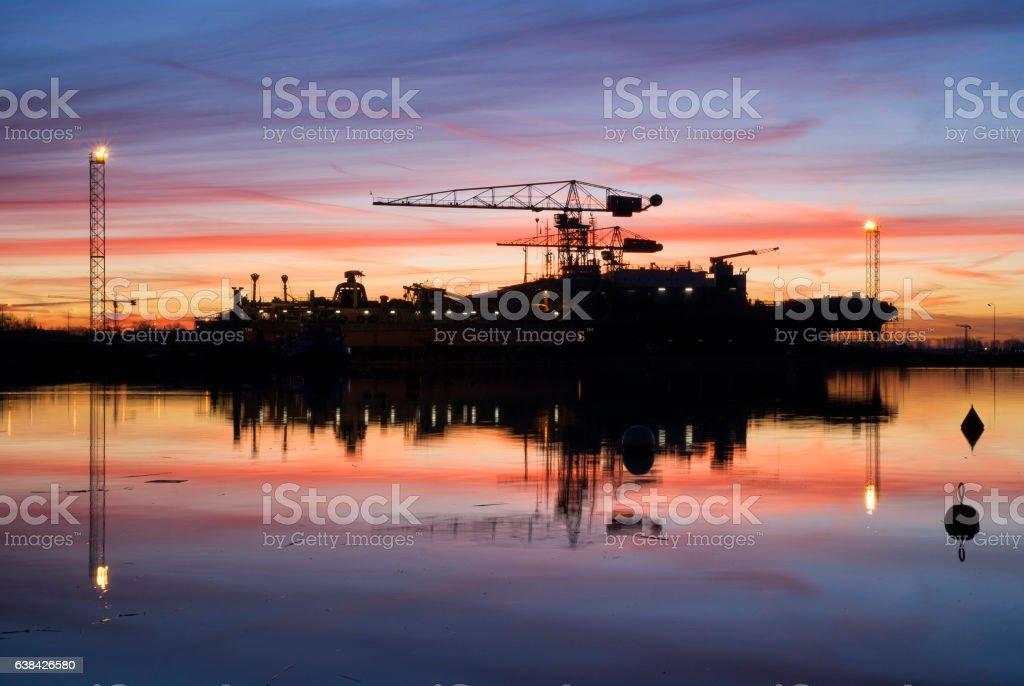 Sunrise above a shipyard stock photo