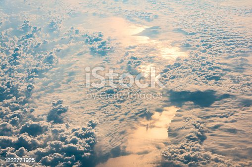 540203788 istock photo Sunrise above clouds and sea from airplane window. Natural background. 1222771925