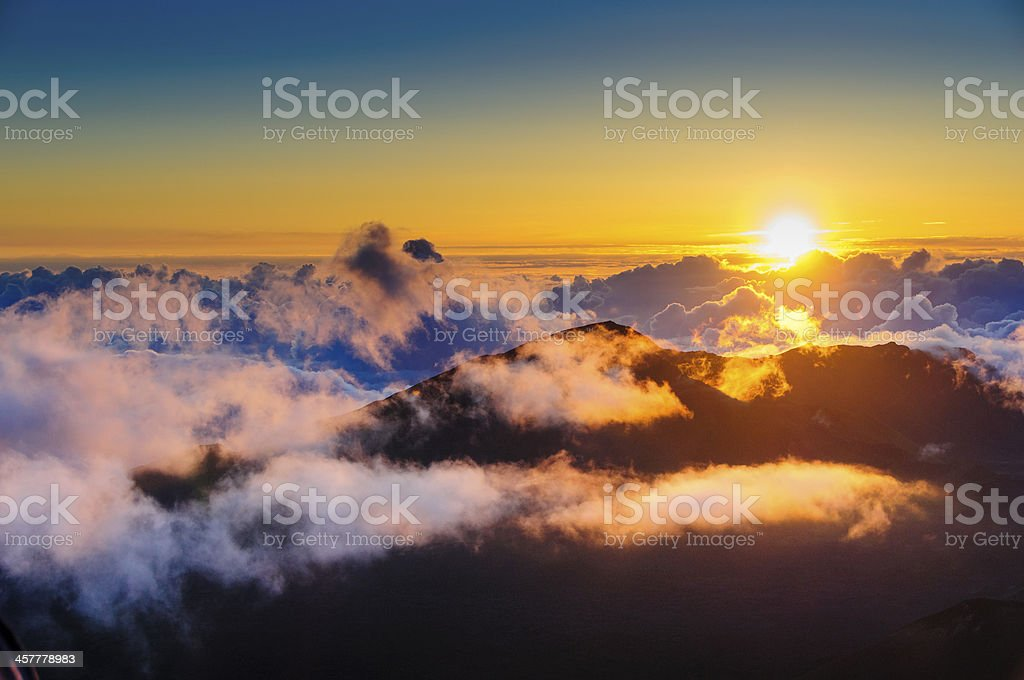 Sunrise above Haleakala Crater, Maui, Hawaii, with clouds stock photo