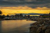 Sunrise above Santa Cruz harbor in Monterey bay, California. Long exposure.