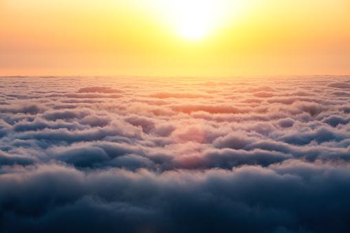 Colorful sunrise above the clouds (Madeira island, Portugal).