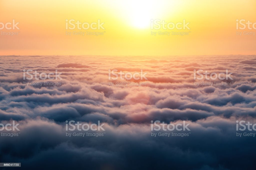 Sunrise Above The Clouds stock photo