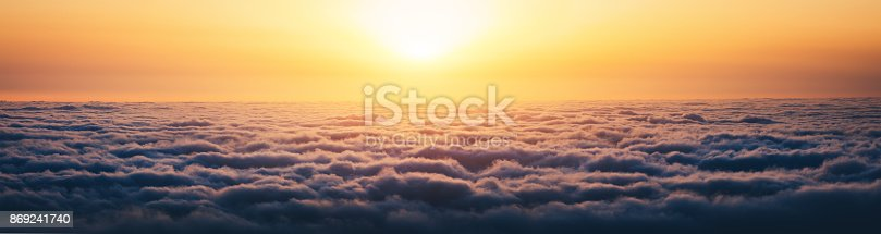 Colorful sunrise above the clouds (Madeira island, Portugal).