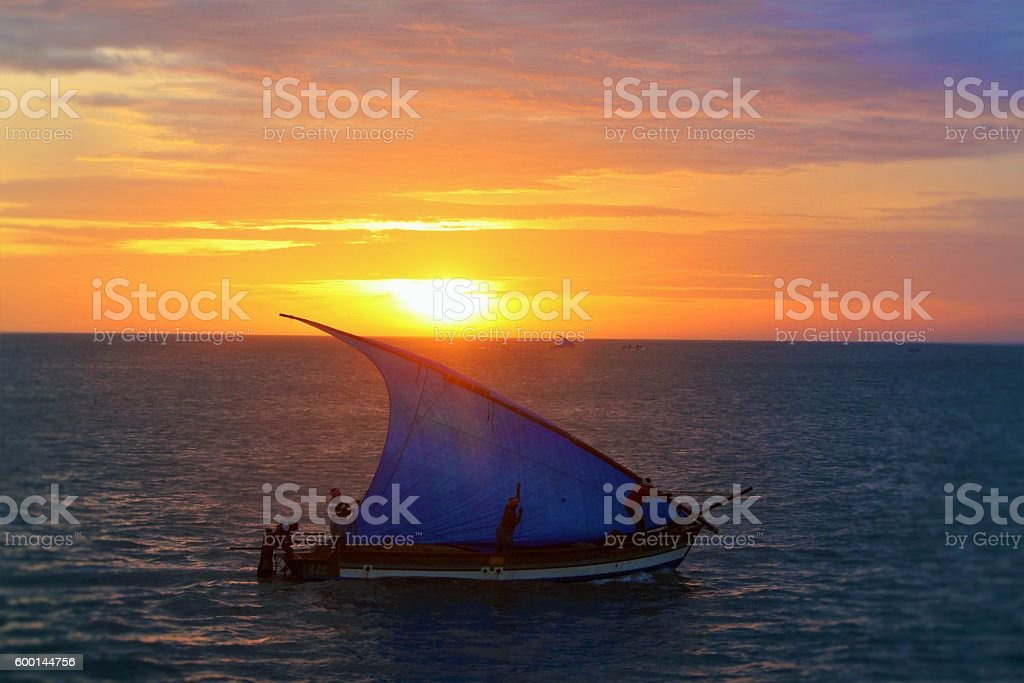 Sunrise against a blue boat stock photo