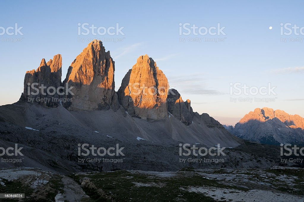 Sunrise and moon on Tre Cime di Lavaredo royalty-free stock photo