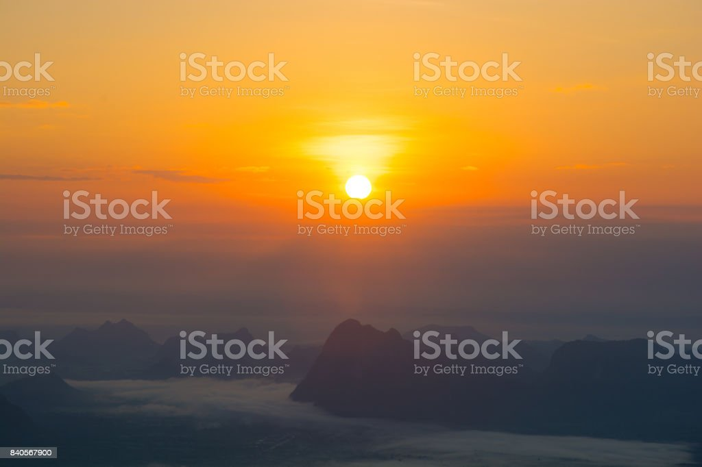 Sunrise and Morning mist with mountain at Phu Kradueng national park ,Loei Thailand. stock photo
