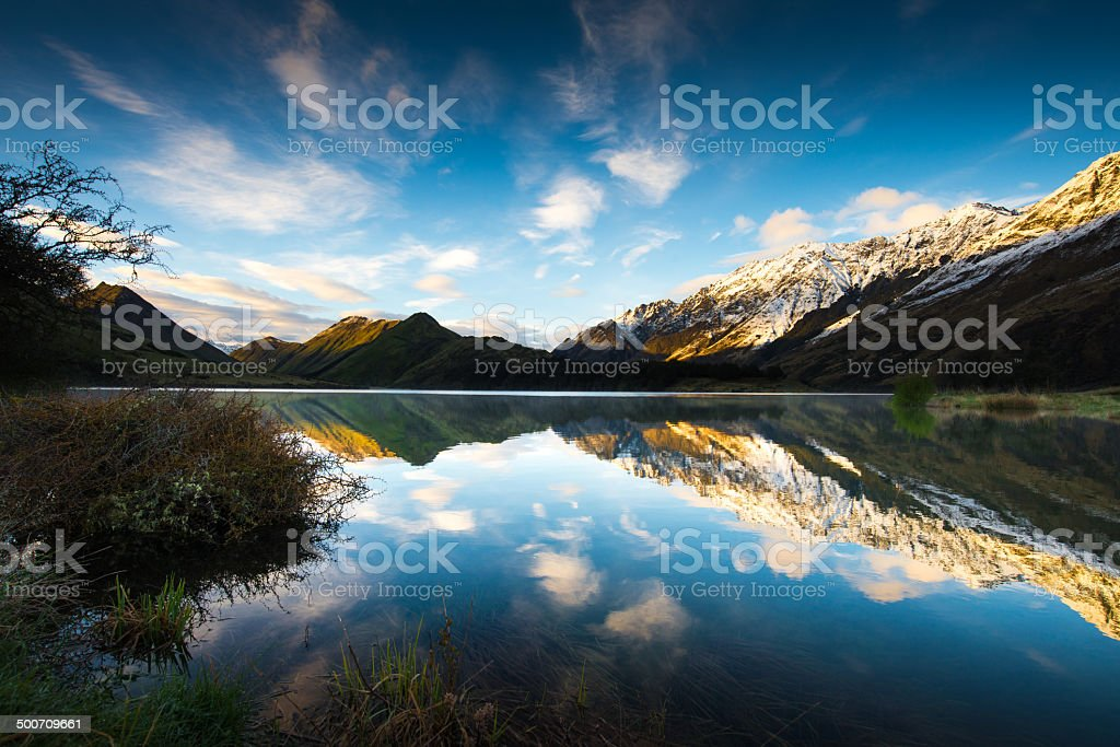 Sunrise and Reflection View of Moke Lake near Queenstown stock photo