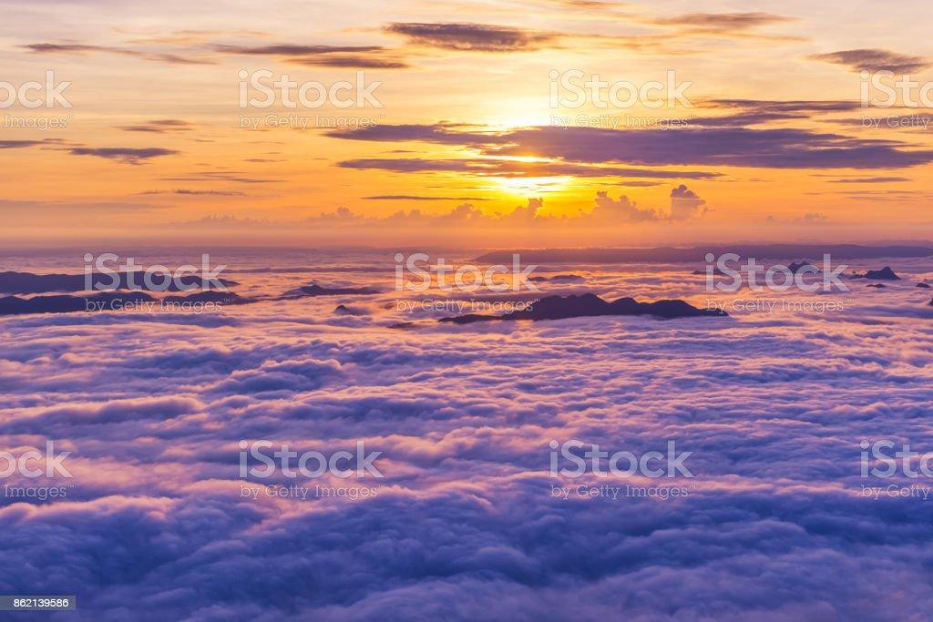 Sunrise and Sea of fog at pah nok ann at Phu Kradueng National Park , Loei Thailand stock photo