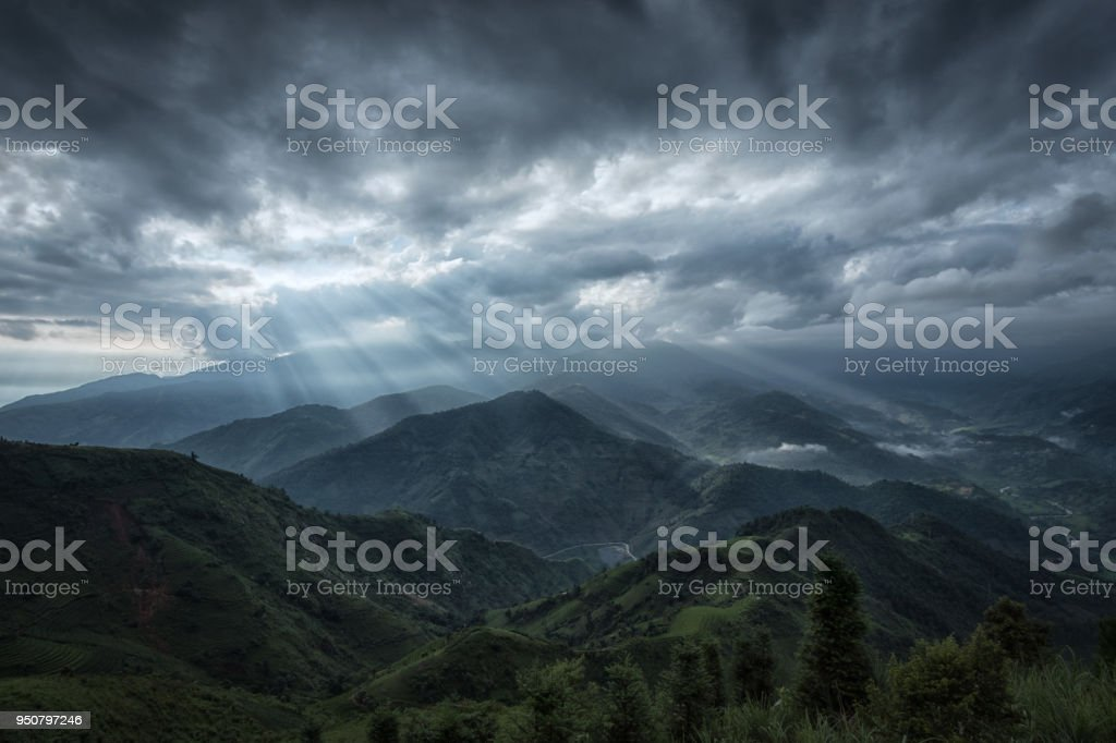 Sunrise and sunbeams over mountains in Vietnam stock photo