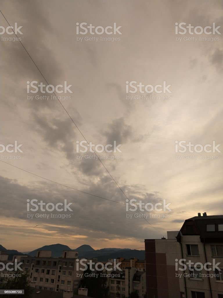 Sunrise and sunset over the hills and town. royalty-free stock photo