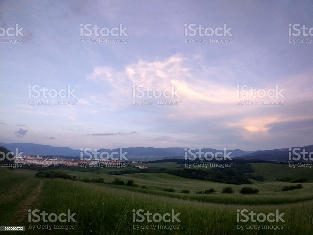 Sunrise and sunset over the hills and town. zbiór zdjęć royalty-free