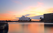 Sydney, Australia - September 17, 2014;  Sydney wakes up to colourful spring skies at sunrise.  Sydney Opera House and Sydney Harbourfrom Circular Quay Sydney.
