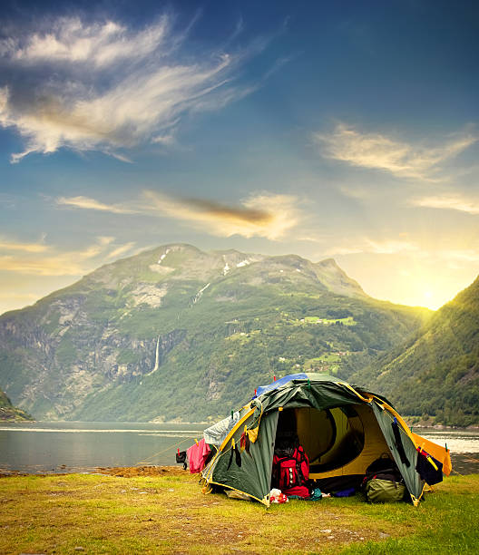 Sunrise and Tent in summer in Norwa stock photo