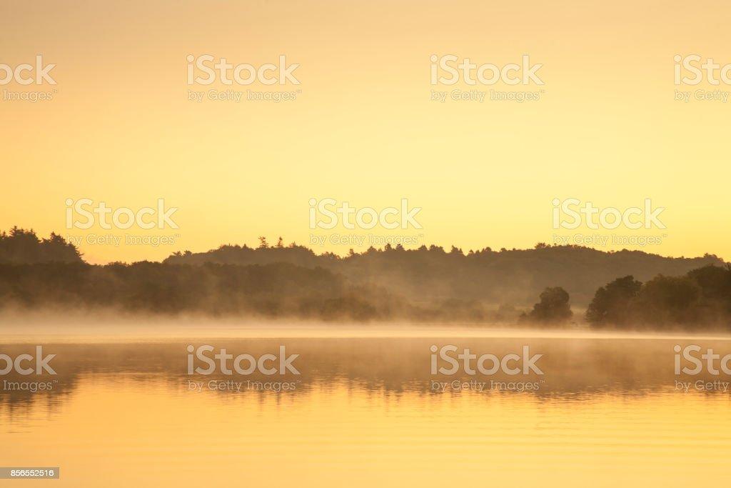 sunrise at a lake stock photo