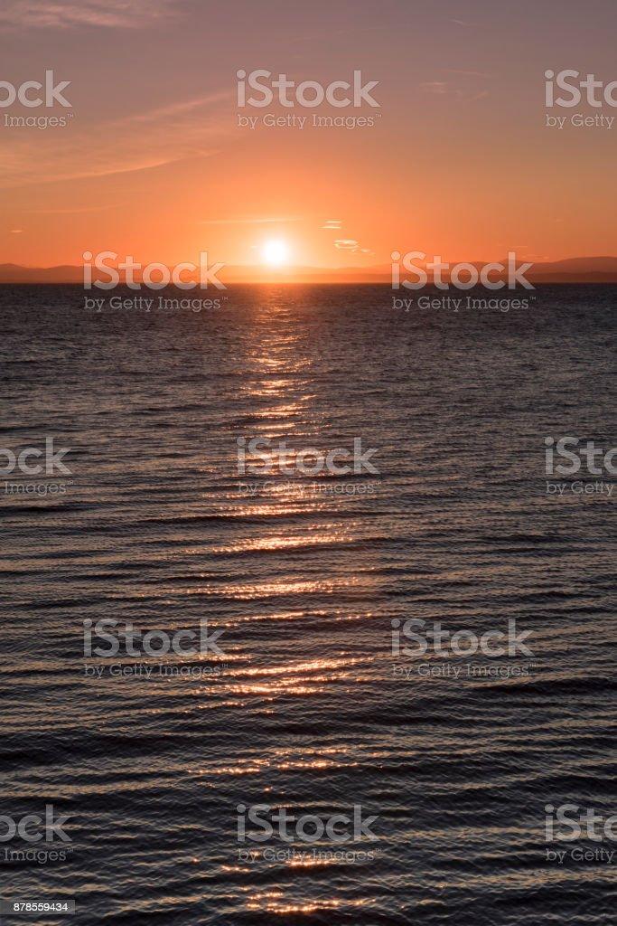 Sunrise at Aegean Sea and Turkish coastline stock photo