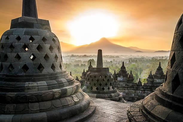 sunrise at borobudur - indonesia stock photos and pictures