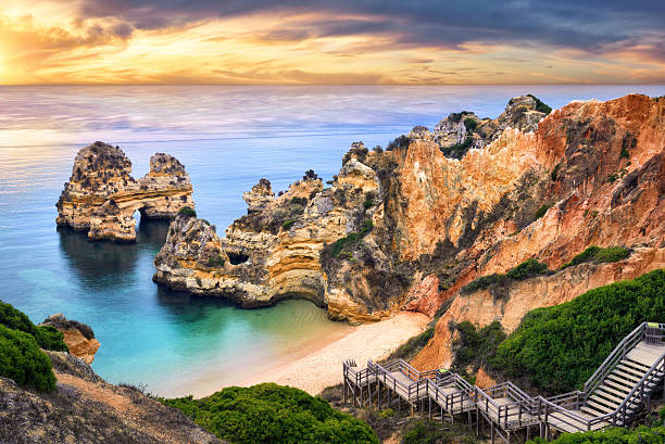 sunrise at camilo beach, lagos, portugal - portugal stock photos and pictures