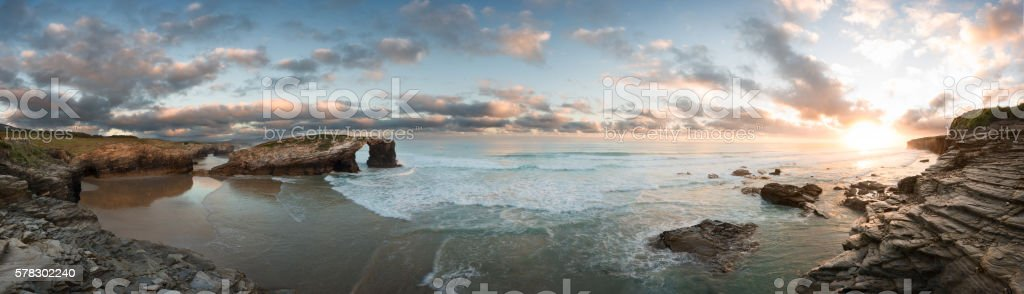 Sunrise at Catedrales beach in Galicia on summer stock photo