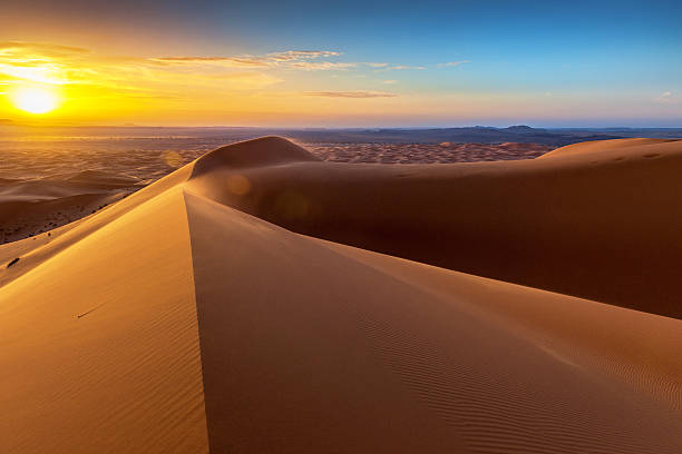 sunrise at erg chebbi sand dunes, morocco,north africa - sand dune stock photos and pictures