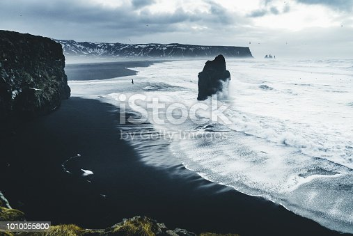 istock Sunrise at famous Black Sand Beach Reynisfjara in Iceland. Windy Morning. Ocean Waves. Colorful Sky. Morning Sunset 1010055800